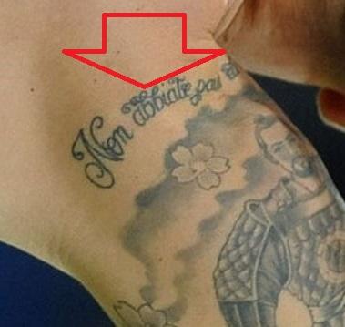 Fabio wriitng on shoulder-