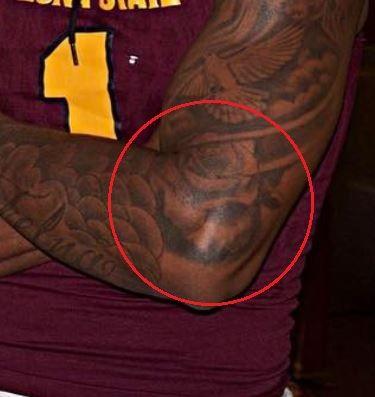 NKeal Harry rose tattoo