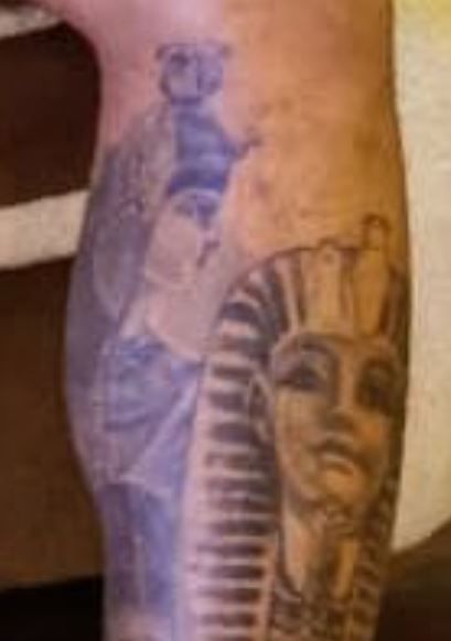 Nathaneil left leg tattoo-