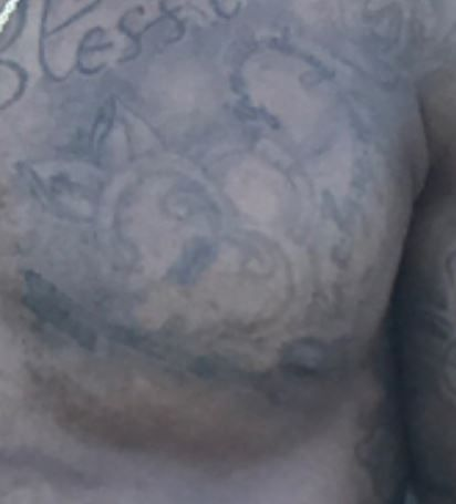 Robert left pec tattoo