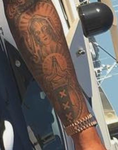 Justi left arm tattoo