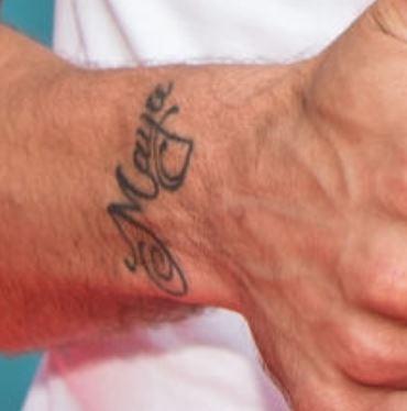 Lukas Podolski name tattoo
