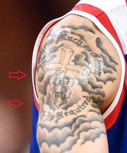 Shane Larkin cross tattoo