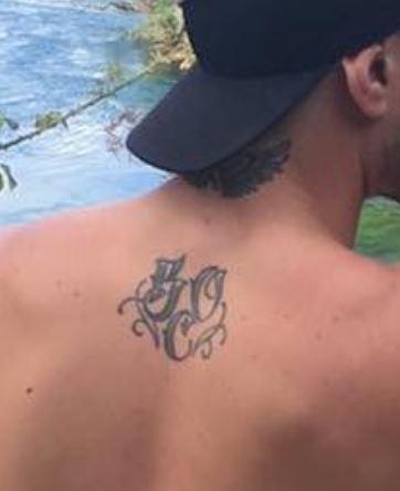 TJ Perenara wings letters tattoo