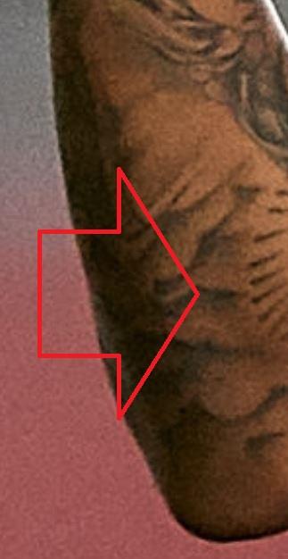 Eder clouds on arm tattoo