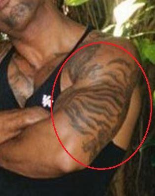 Mike Holston stripes tattoo