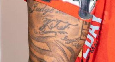 PJ Tucker initials tattoo