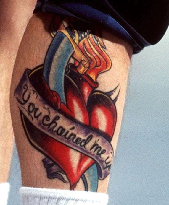 Stefan heart with quote on leg tattoo