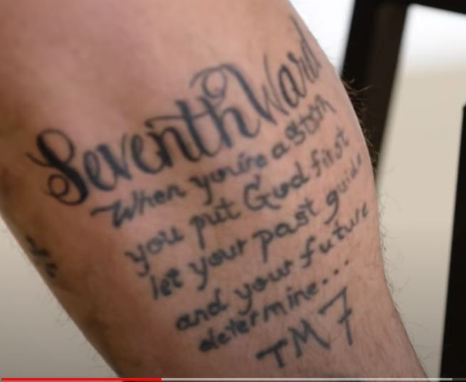 Tyrann Quote on leg tattoo
