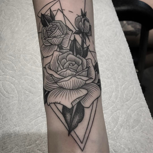 alex dorame rose geometric design forearm tattoo