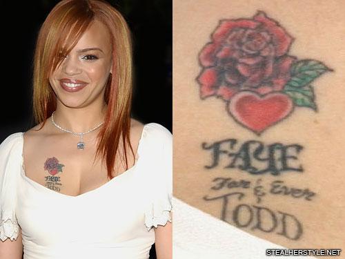 faith evans rose chest tattoo