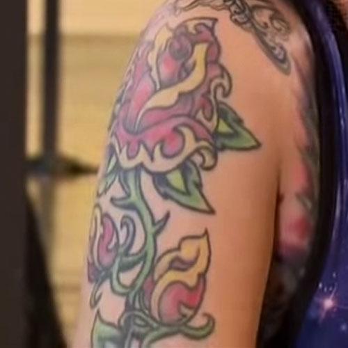 megan massacre rose arm tattoo