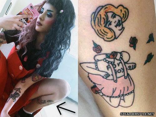 melanie martinez decapitated leg tattoo