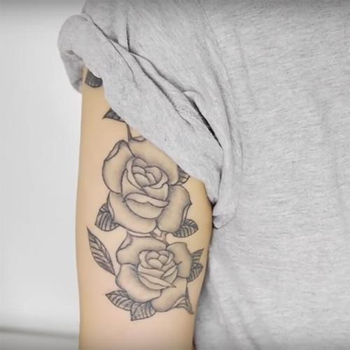 samantha maria upper arm rose tattoo