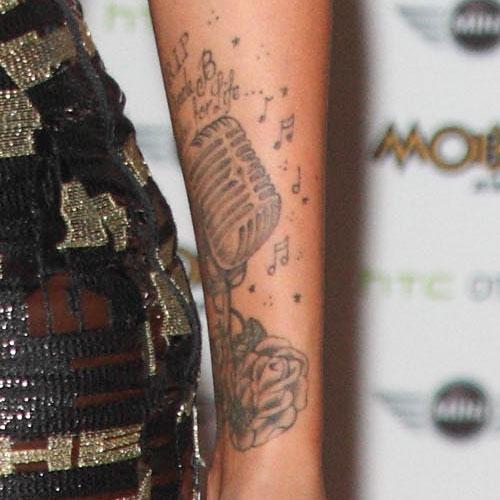 tulisa lower microphone arm tattoo