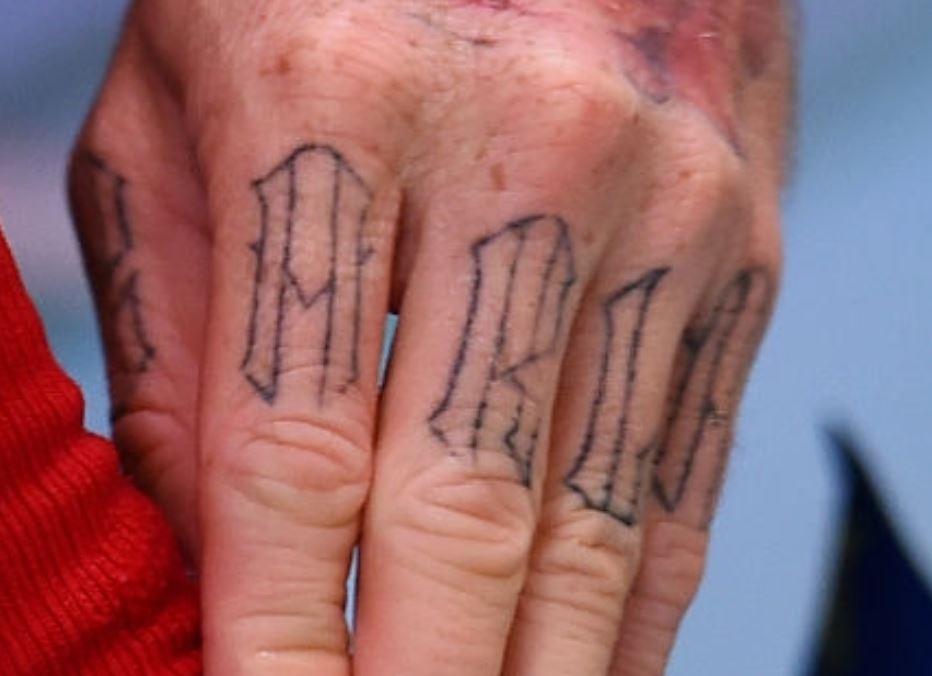 Alberto left hand finger tattoo