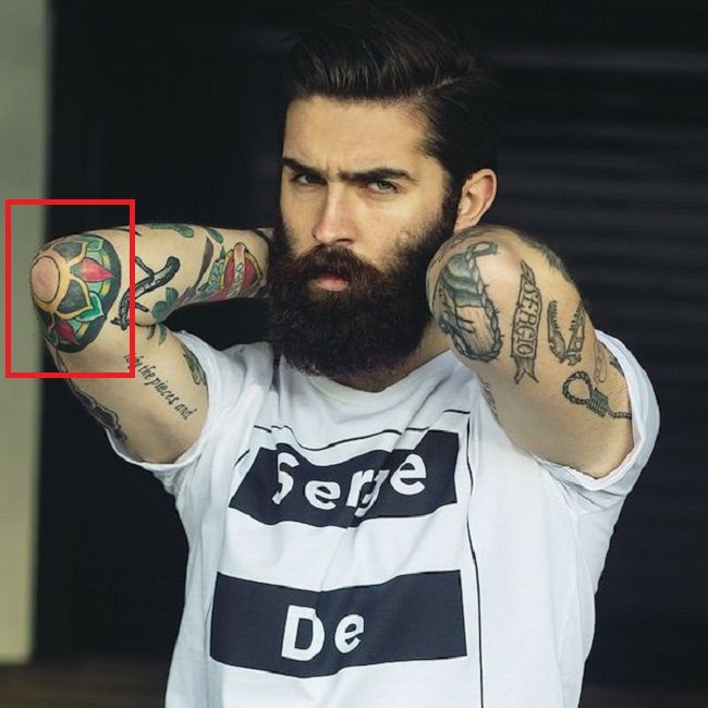 Chris John-Millington-Tat