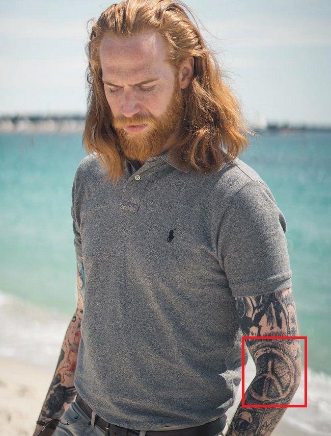 Gwilym Pugh-Peace Symbol-Tattoo