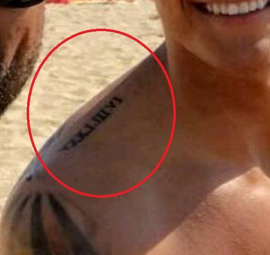 Davie roman numerals on shoulder blade