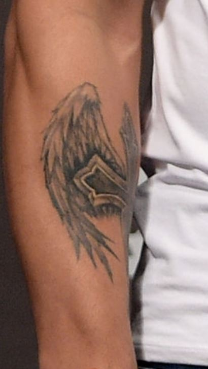 Erick cross and angel wings tattoo