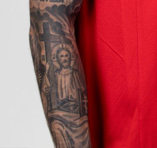 Fyodor Jesus Christ on forearm tattoo