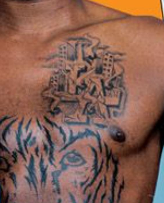 Gilbert left pec tattoo