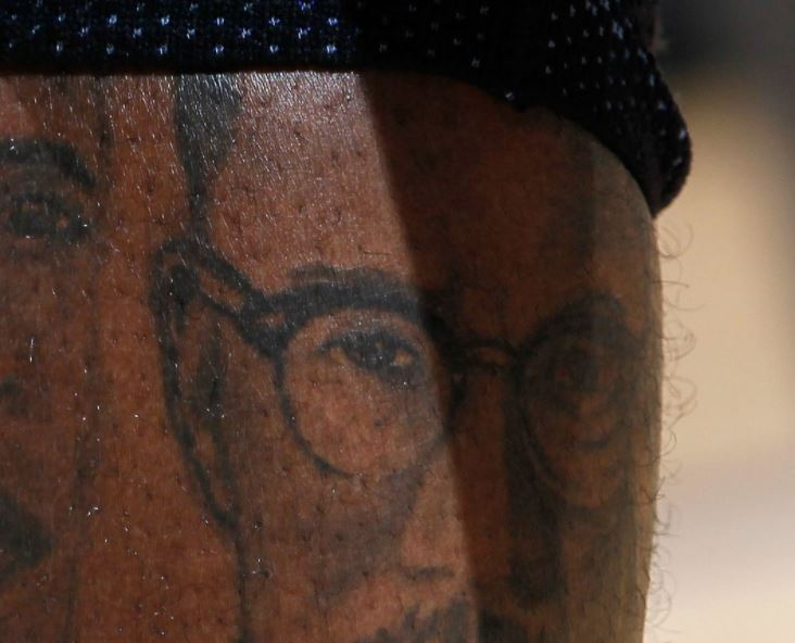 Gilbert leg portrait tattoo