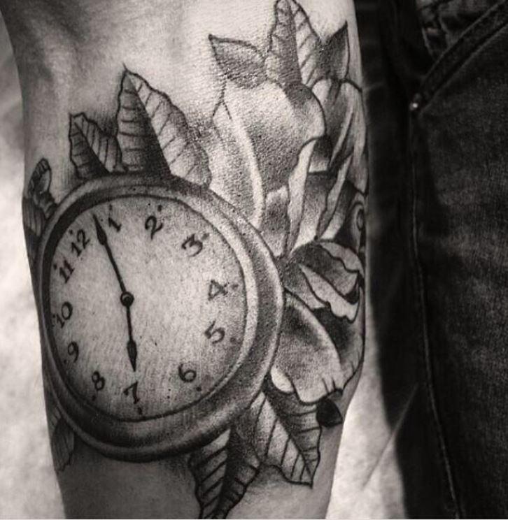 Javier clock tattoo