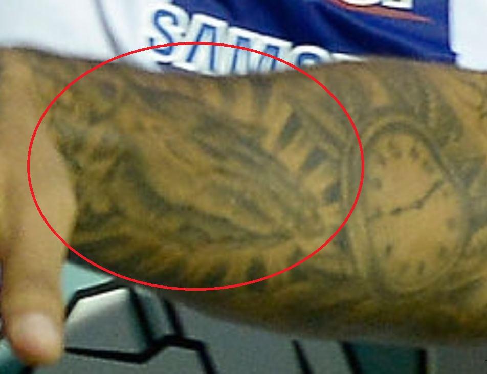 Javier praying hands tattoo