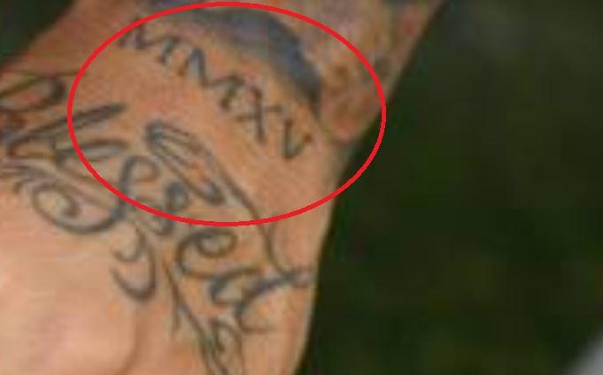 Javier roman numerals tattoo