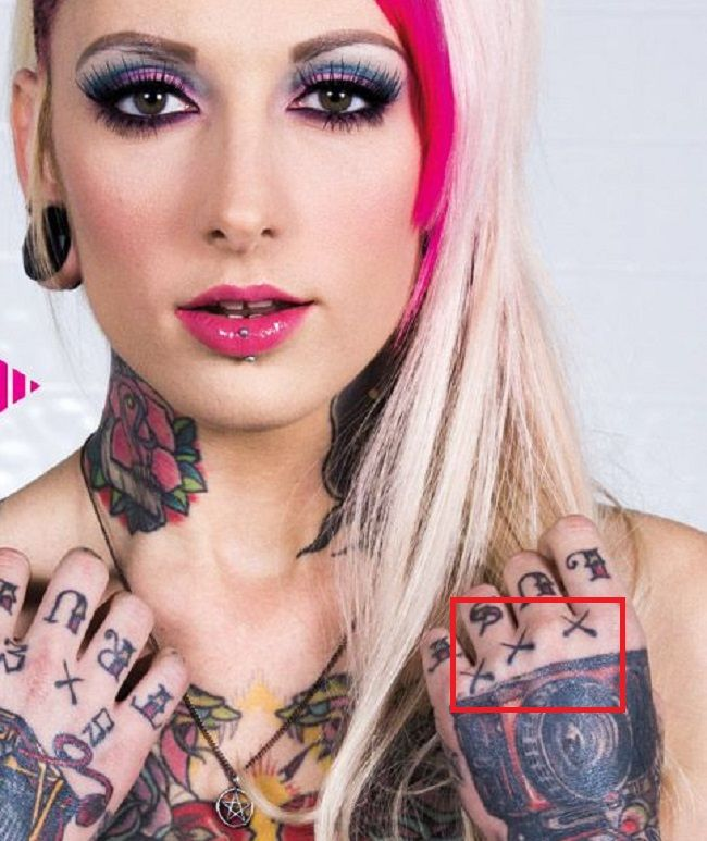 Jessie Lee hand tattoo left