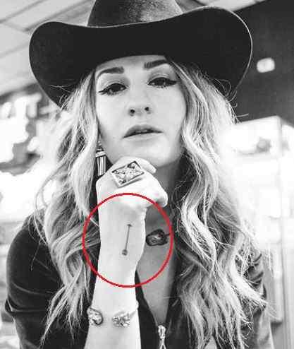 Margo Price arrow tattoo