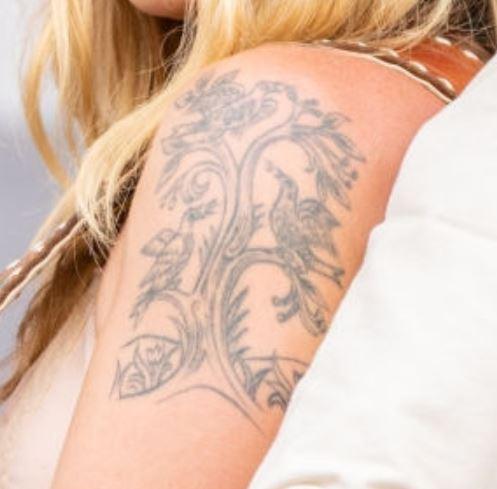 Margo Price tree birds tattoo
