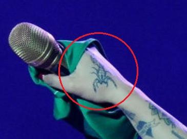 Mon Laferte scorpion tattoo