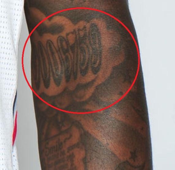 DeShawn number on arm tattoo
