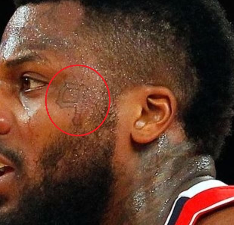 DeShawn tattoo on face