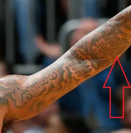 DeShawn writing on arm tattoo