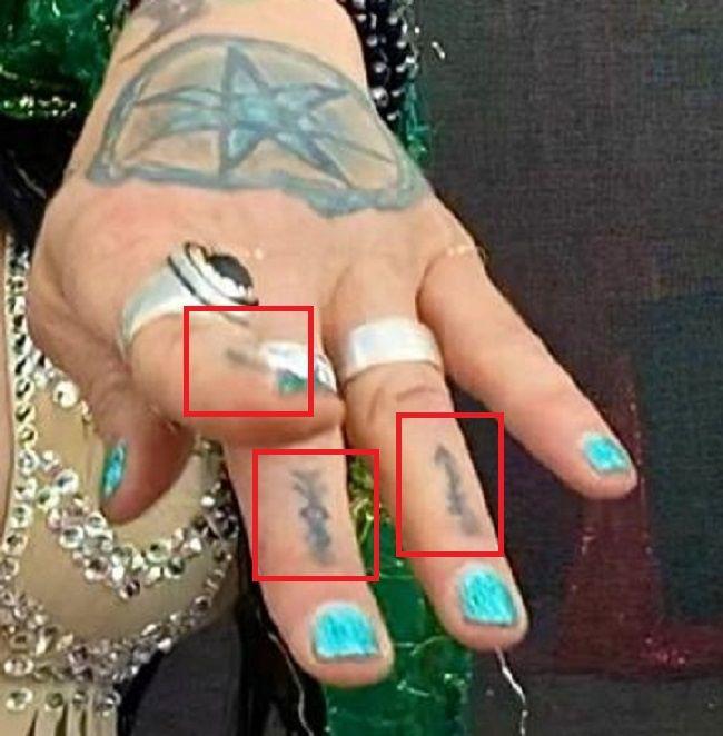 Jenevieve Hexxx-hand tattoos