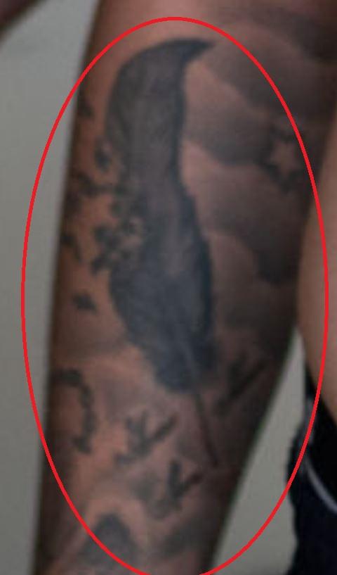 Marius feather tattoo