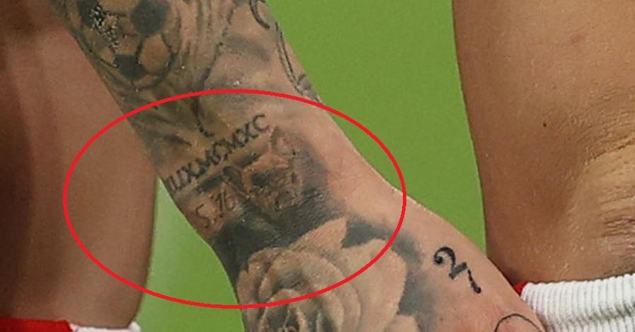 Marius portrait of dog and roman numerals tattoo