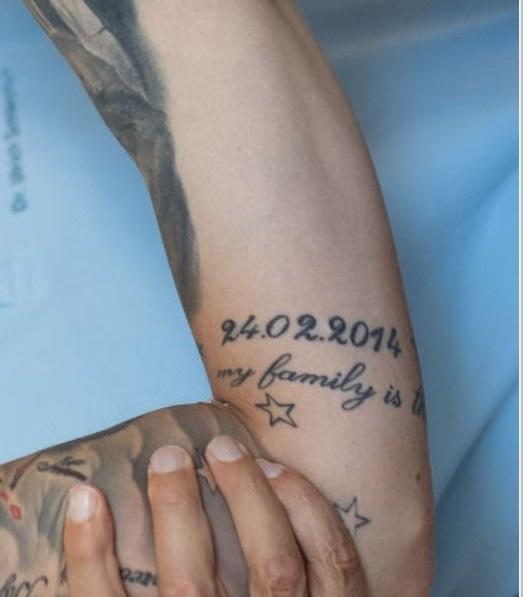 Marius quote on arm tattoo