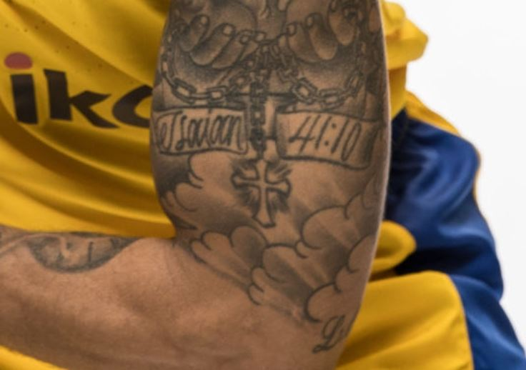 Scottie bicep tattoo