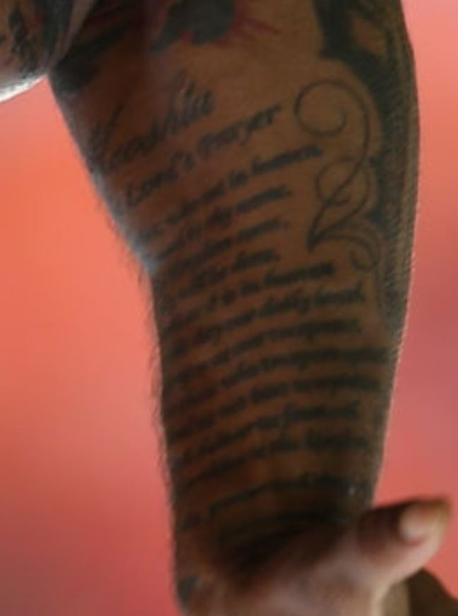 West writing on arm tattoo