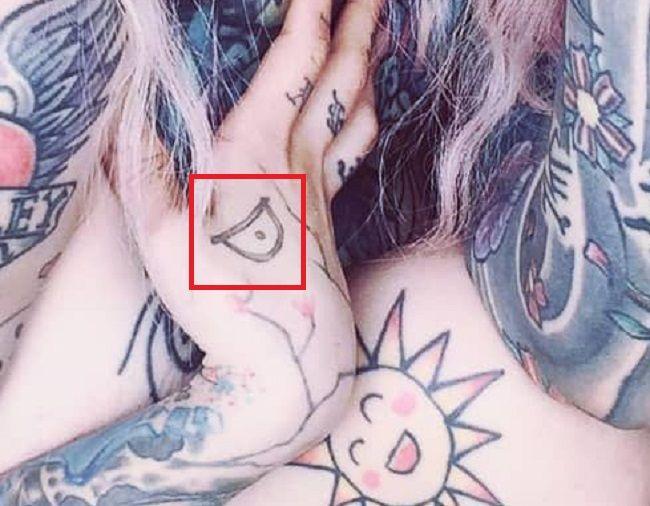 right hand tattoo of vicious sydnee