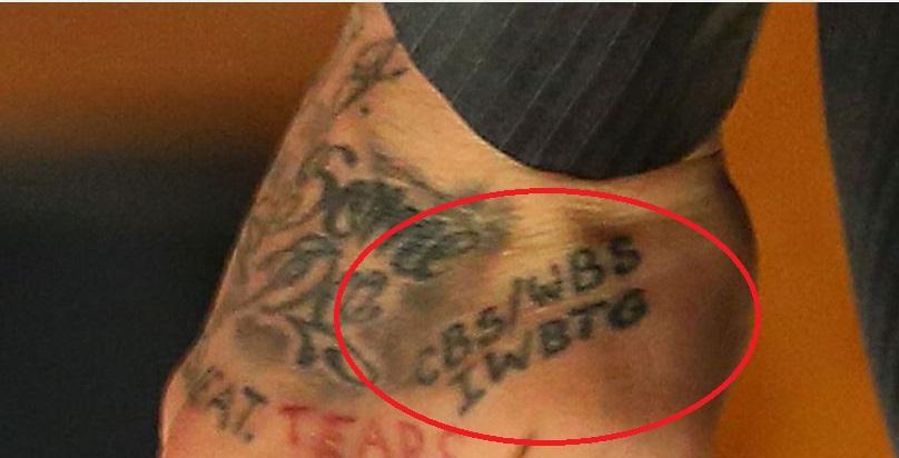 Aaron left hand tattoo