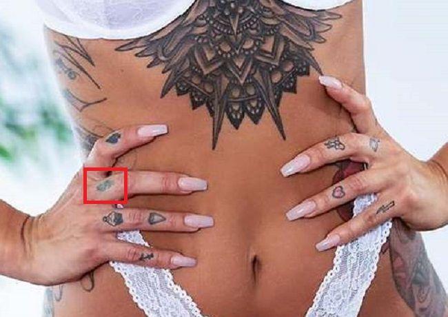 Alison Avery-Dollar Sign Tattoo