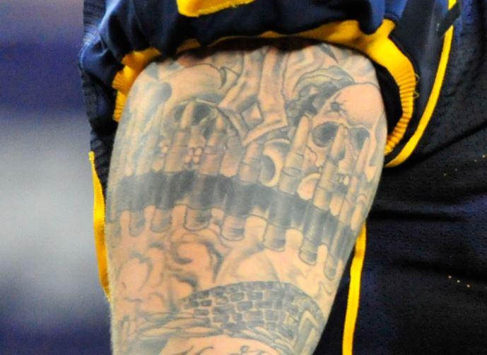 Brian bicep skulls and band tattoo