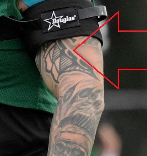 Brian tribal arm tattoo
