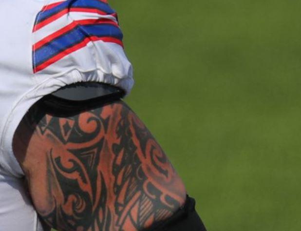 Brian tribal bicep tattoo