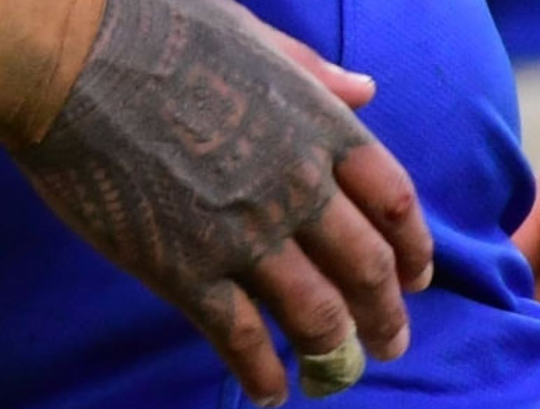Courtney hand tattoo